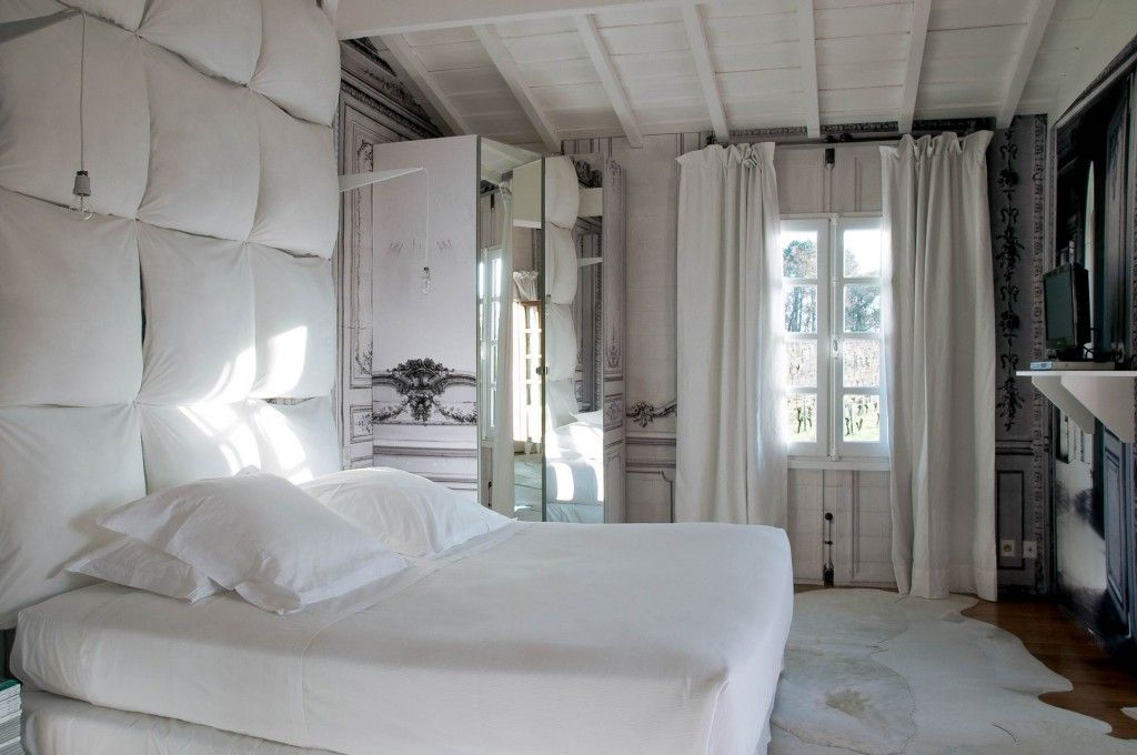 French Apartment Baroque Eclectic Modern Interior Design. Light bedroom with soft paneled wall