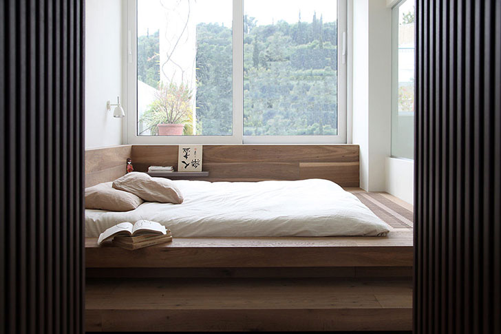 Japanese styled bedroom with platform bed and full of light