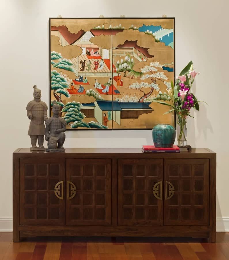 Hallway interior in Japanese style with characteristic figurines, ink picture on rice paper and ancient oriental styled chest of drawers