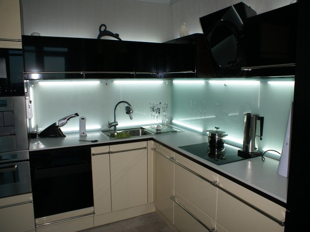 Black modern kitchens design with skinali backsplash and neon lighting