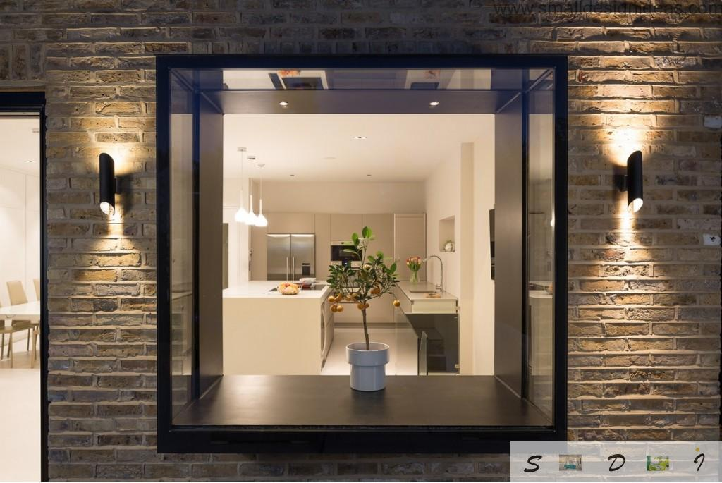Nice glass chamber instead of conventional windows adding some space and zest to the house interior