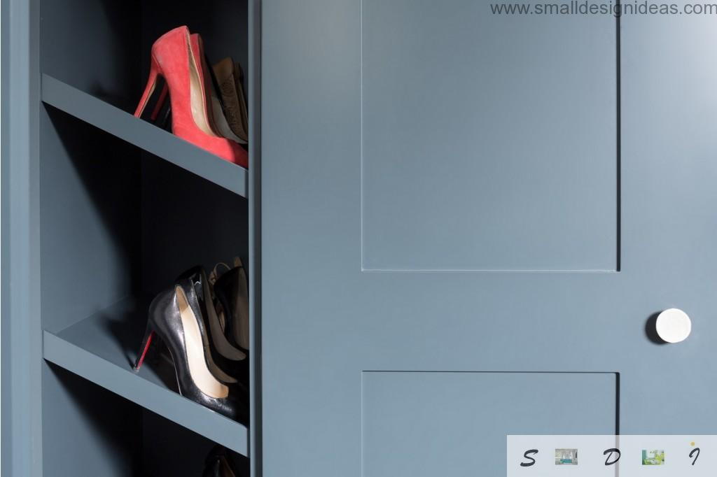 Utilitarian shoe storage in the cabinet of the modern English house