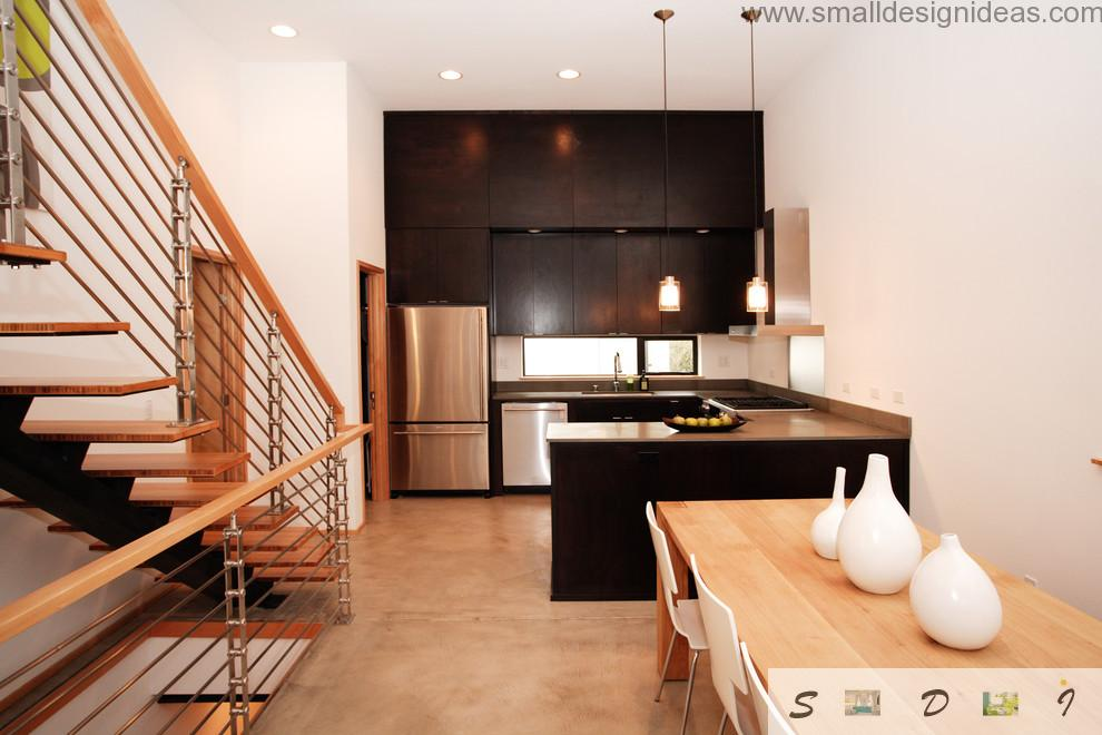 Black kitchen set and white contrasting walls and ceiling in the design project of modern kitchen