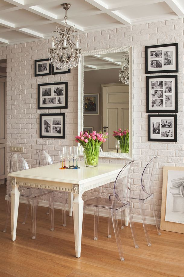 plastered brickwork for the modern kitchen interior blends very good with transparent chairs