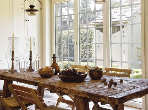 High ceiling rustic interior with sash windows and large wooden table