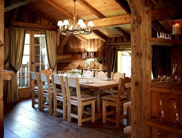 Chalet or rustical dining room with all-wooden decorated space