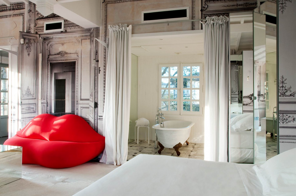 French Apartment Baroque Eclectic Modern Interior Design. bedroom studio with the bathtub and soft frameless armchair in  the form of lips
