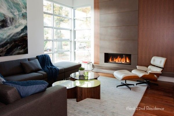 Real hearth and the armchair for relaxing is the main trend of the Canadian suburban residence