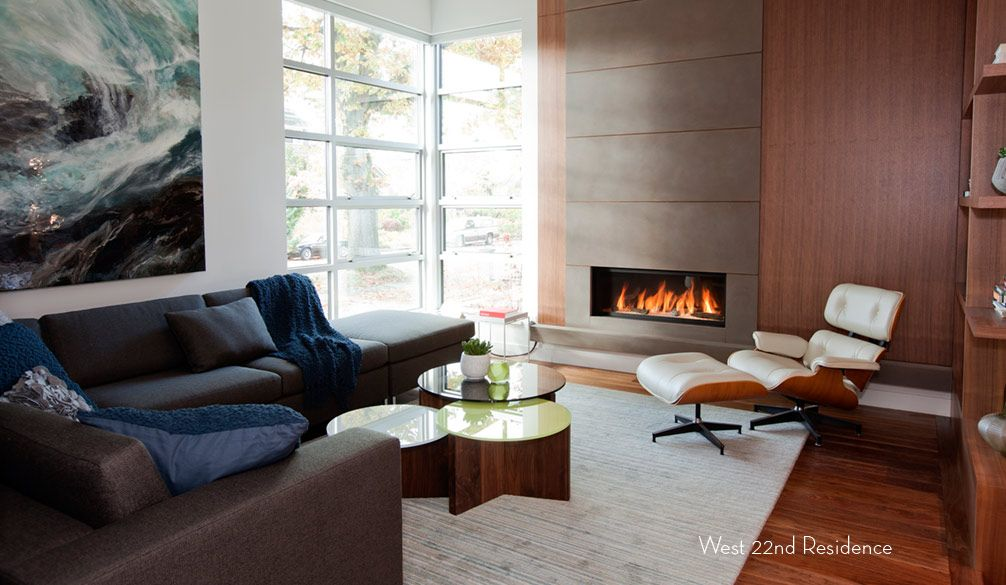 Canadian House Interior Design Review. Real hearth and the armchair for relaxing  is the main trend of the Canadian suburban residence