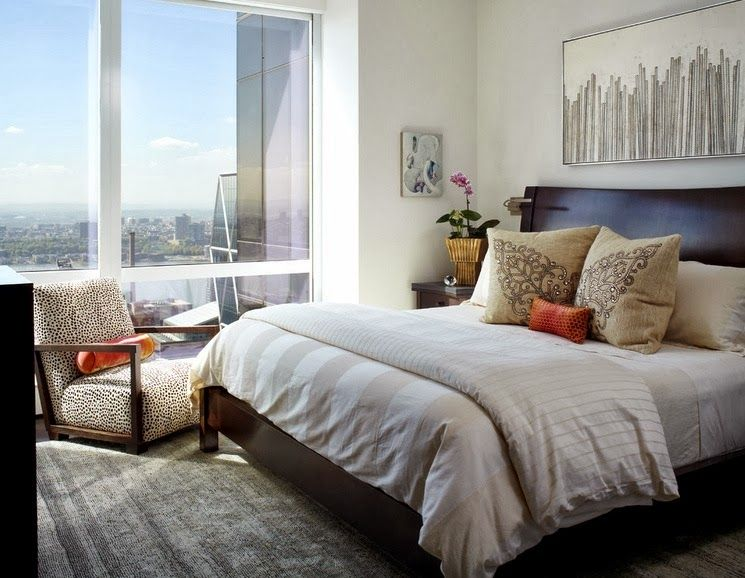 Light modern bedroom design is not devoid of decorative embroidery on pillows