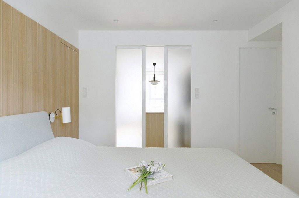 White Minimalistic Hong Kong Apartment Interior Design Ideas. Frosted glass inner door complements white trim
