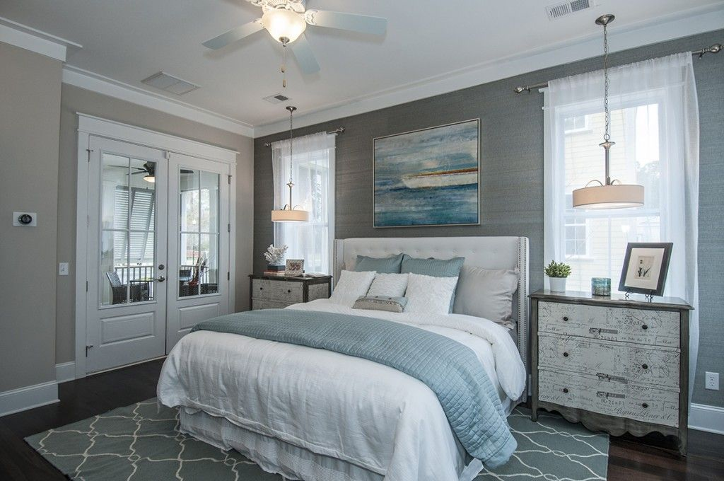 Soothing marine colors in the women`s bedroom interior