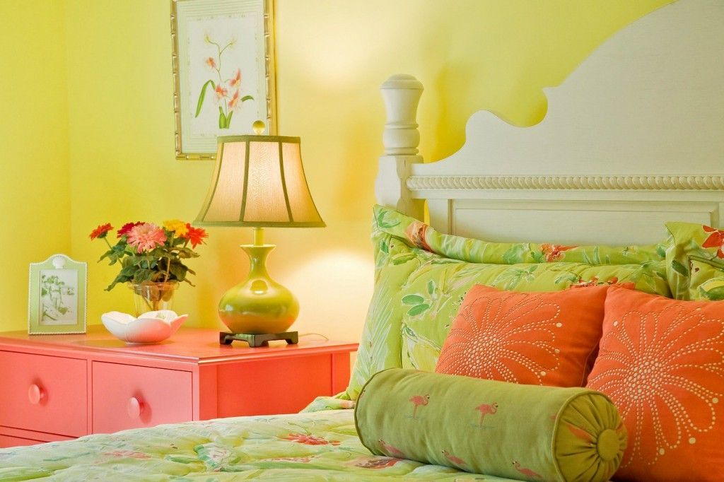 Bright green and yellow tones in the women`s bedroom