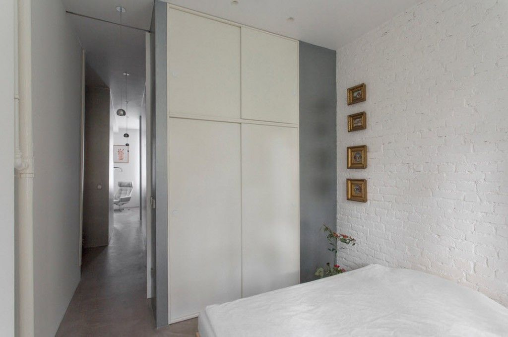 Small 150 Square Feet German Apartment Interior Design Ideas. Austere white bedroom with glossy wardrobe