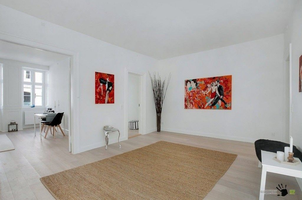 Danish apartment in the Scandinavian style. Living room in modest white finish