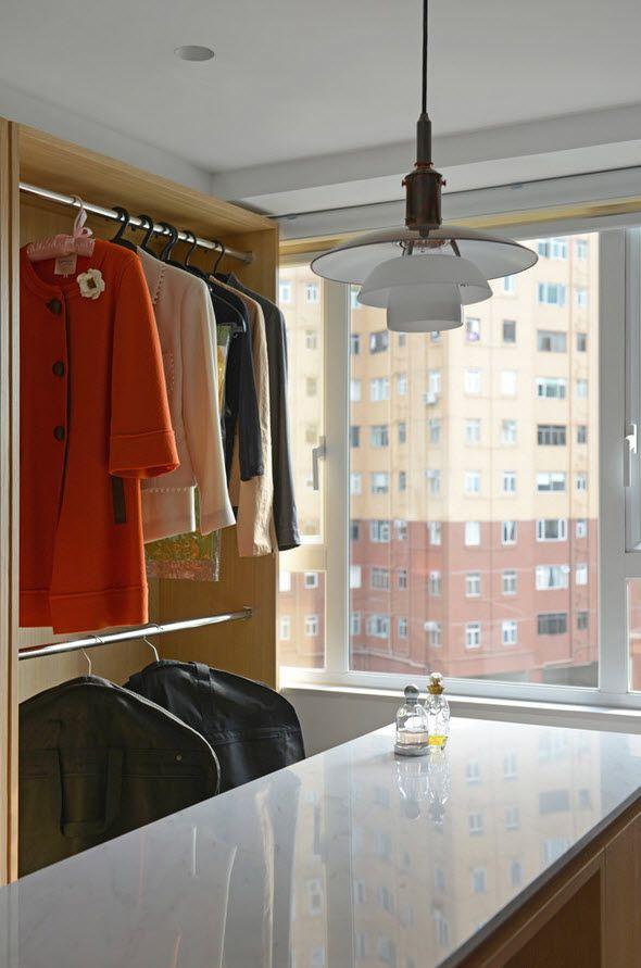 White Minimalistic Hong Kong Apartment Interior Design Ideas. Wardrobe design with large window