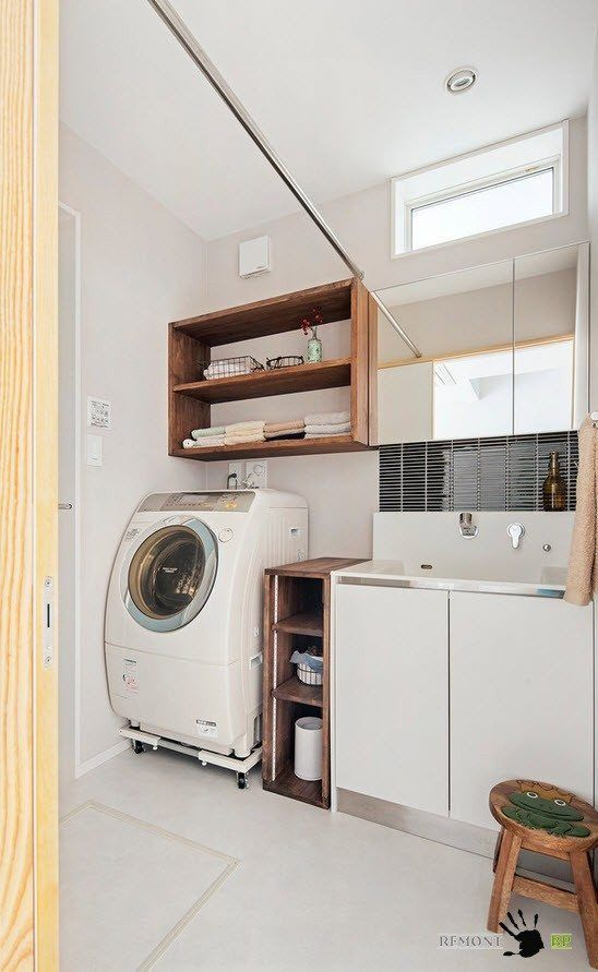 Laundry room of the private Japanese house and minimalistic white interior design