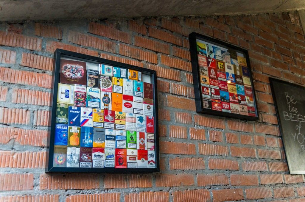 Loft Studio Apartment Interior Design Ideas in real photos. Decorative wall with cigarette packs