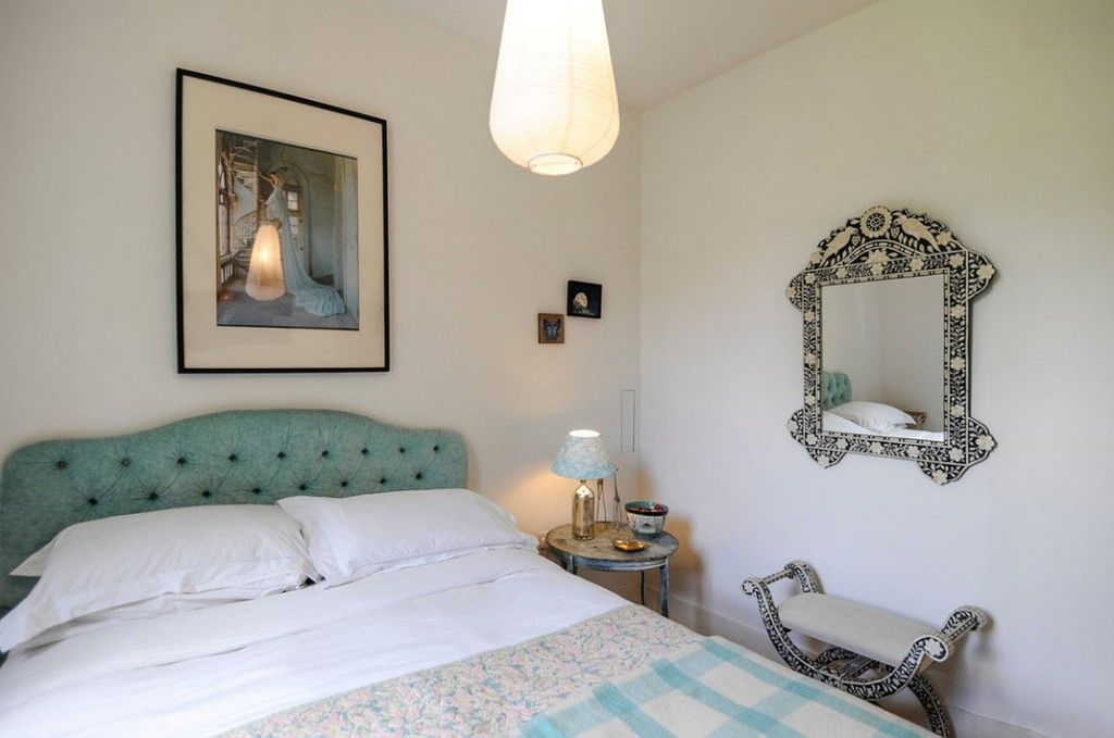 London Apartment Eclectic Interior Design Ideas. Low-key lighting and silver framed boudoir in the bedroom