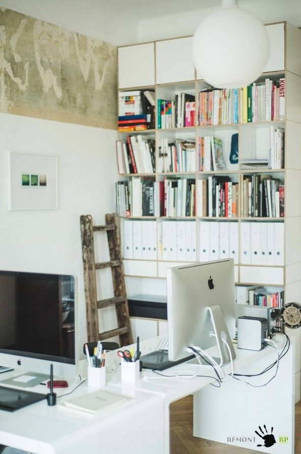 Home office with retro and modern style book shelves and ladder