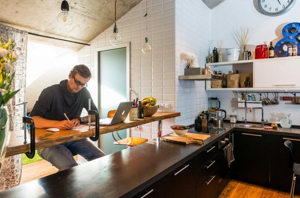 Loft Studio Apartment Interior Design Ideas in real photos. Unique kitchen bar of wood for additional activity