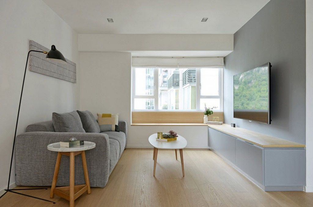White Minimalistic Hong Kong Apartment Interior Design Ideas. rest zone in the living room with austere furniture