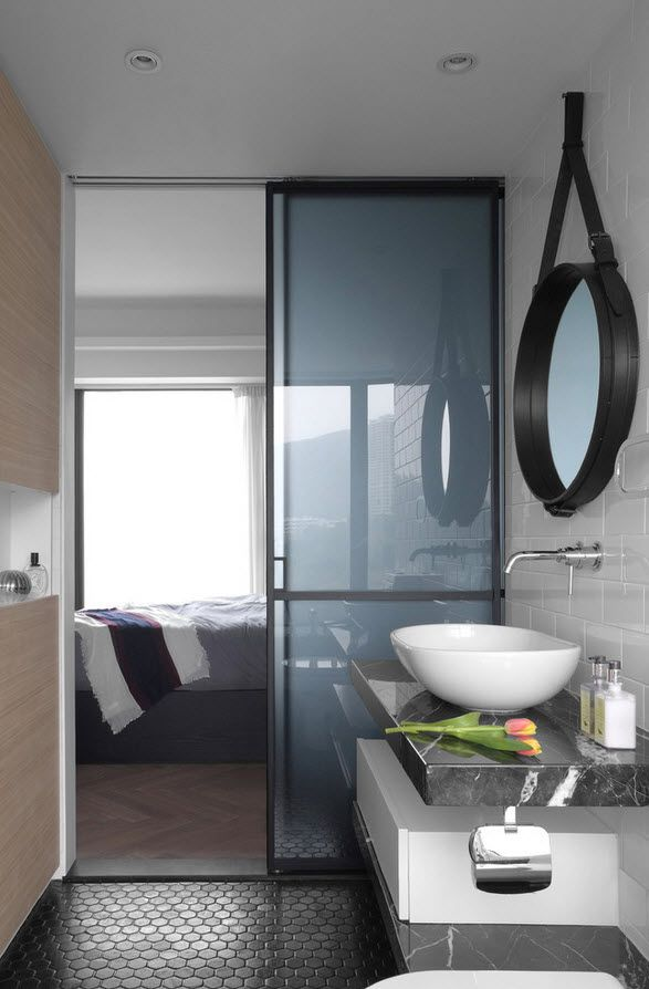 Small leather Mirror frame and a frosted glass leading to the bedroom
