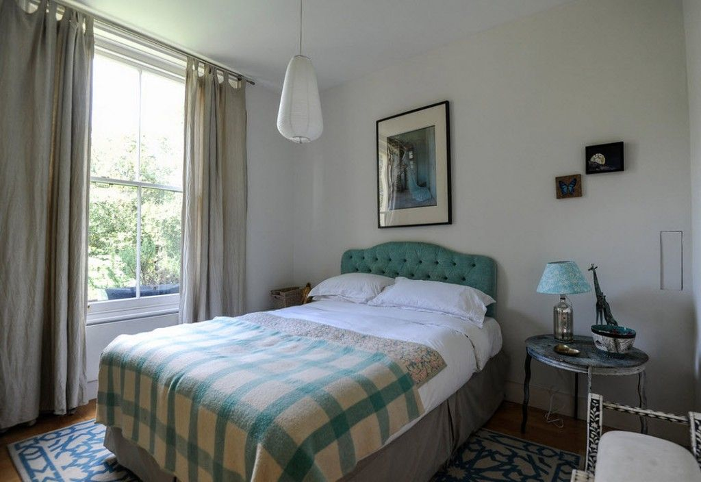 London Apartment Eclectic Interior Design Ideas. Nice turquoise headboard of the classic double bed in the second bedroom