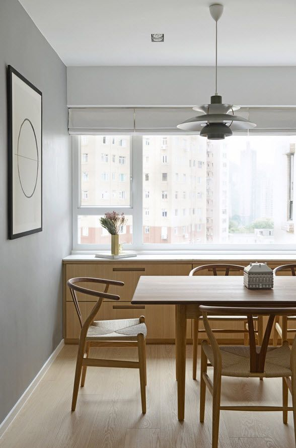 White Minimalistic Hong Kong Apartment Interior Design Ideas. Wide windows and full of light in the dining room