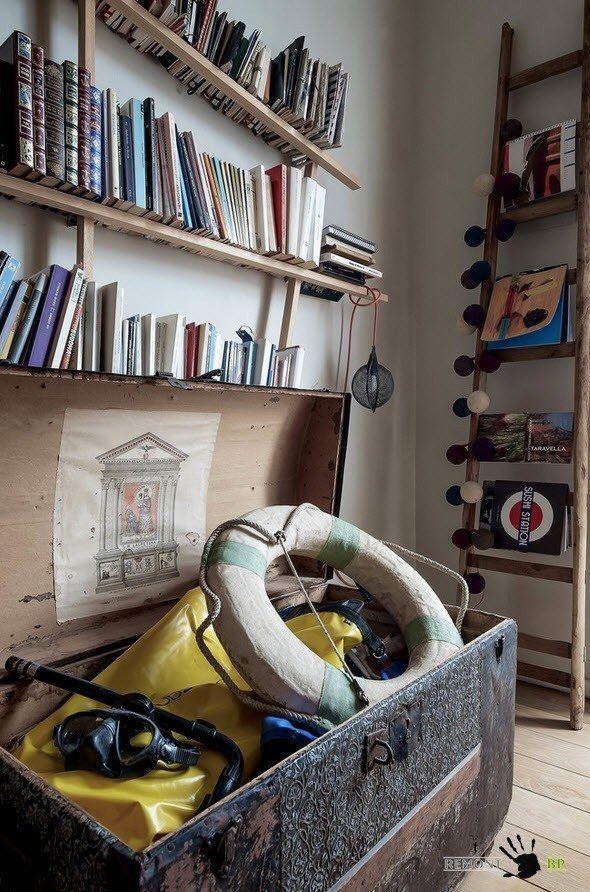 Unique vintage Italian apartment decorated with bookshelves and antique accessories
