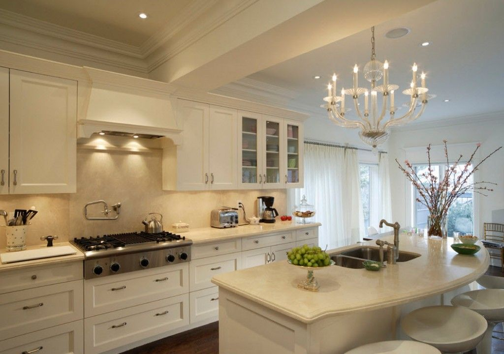 Stylish Kitchen Chandelier Types: Classic to Avant-Garde. Totally white conservative but interesting kitchen interior demands the presents of candle lighting
