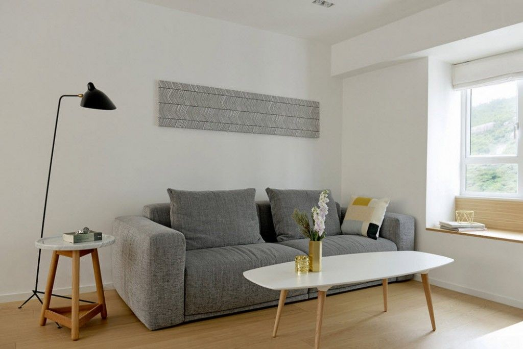 White Minimalistic Hong Kong Apartment Interior Design Ideas. Gray couch against the white walls