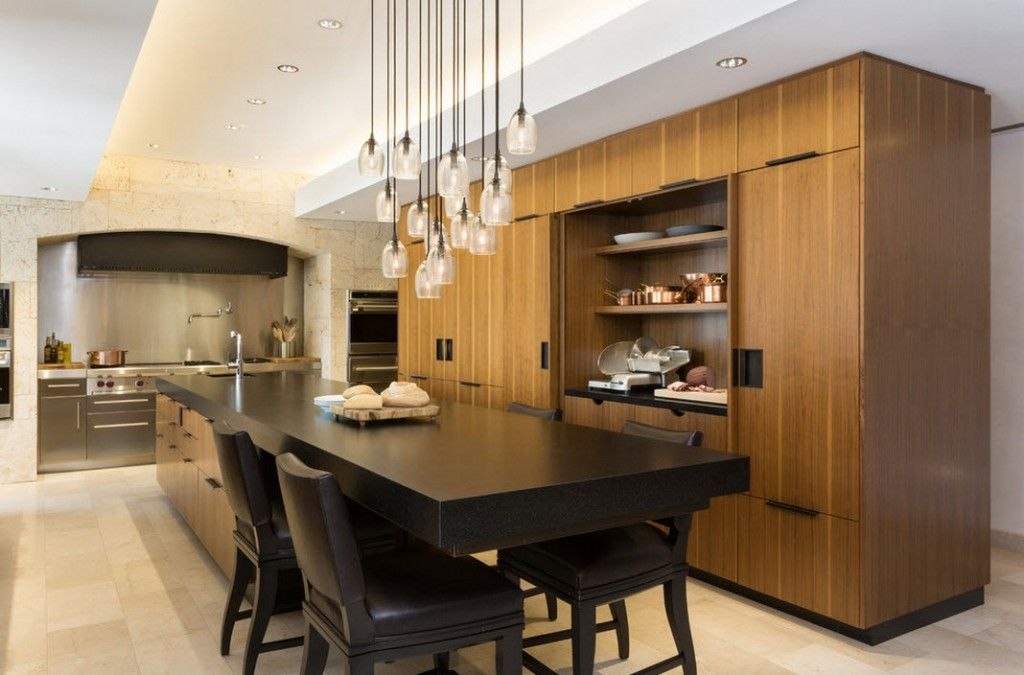 Stylish Kitchen Chandelier Types: Classic to Avant-Garde. Pendant long wired lamp composition and black table of the wooden design of the kitchen