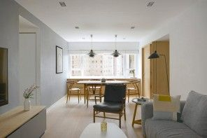 White Minimalistic Hong Kong Apartment Interior Design Ideas. Spacious and light living room with chair