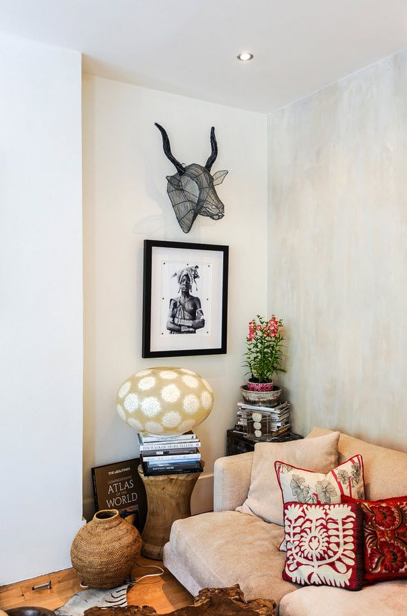 """London Apartment Eclectic Interior Design Ideas. """"traveler`s"""" corner with lots of decorative stuff in the living"""