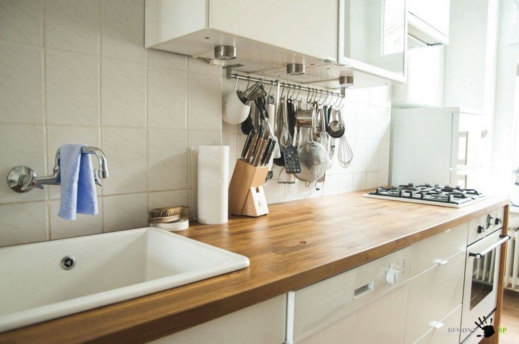 Wooden countertop and tiled backsplash in Retro style kitchen