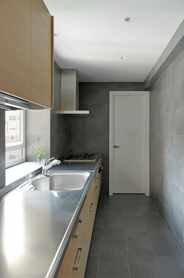 Galley kitchen of Hong Kong minimalistic aparmtent