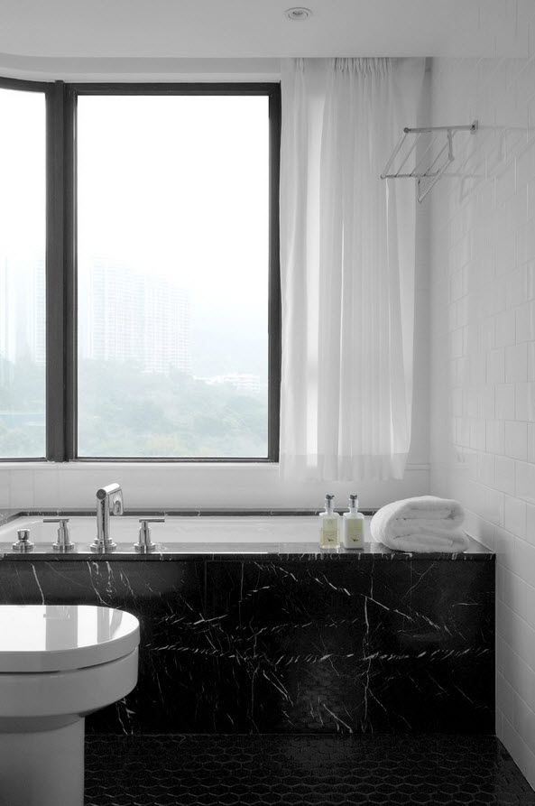 Shanghai Apartment Interior Design Ideas. Large window and chic black marble faced bathtub