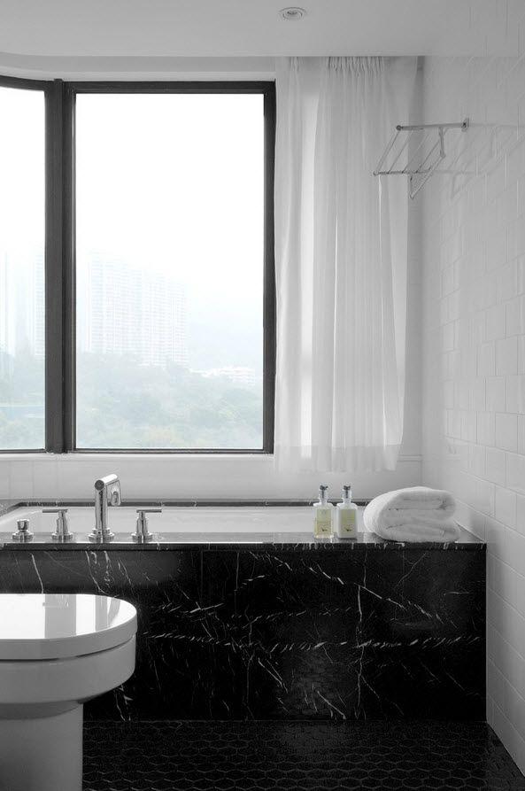 Shanghai Apartment Interior Design Ideas. Large window and chic black marble faced bathtub