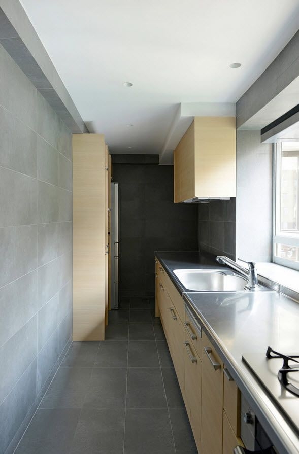 Galley kitchen wooden cabinets and steel tops