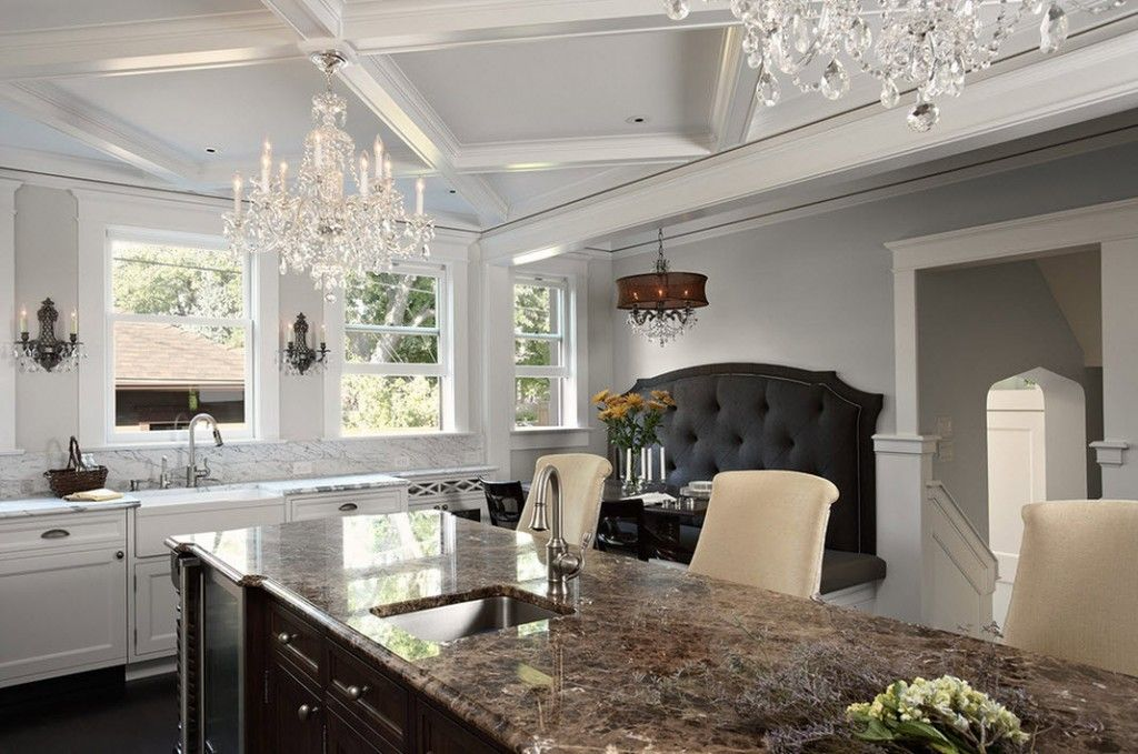 Stylish Kitchen Chandelier Types: Classic to Avant-Garde. Massive marble countertop of the island layout kitchen