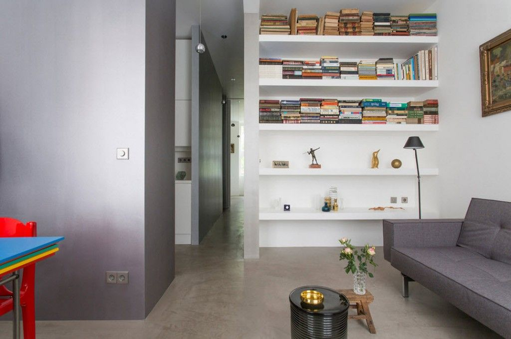 Small 150 Square Feet German Apartment Interior Design Ideas. Living room with wall height shelves