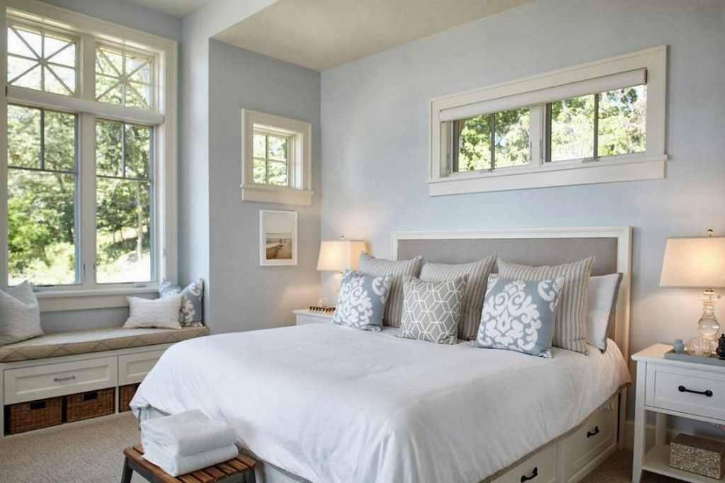Bright womans bedroom with pale blue walls