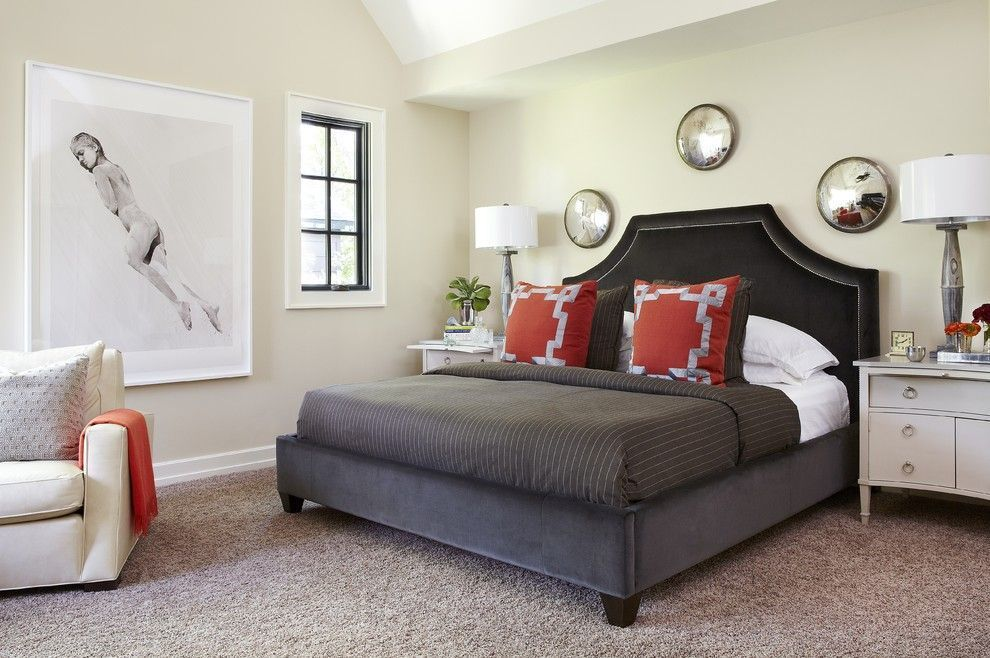 Discreet women`s bedroom with contrasting bed color