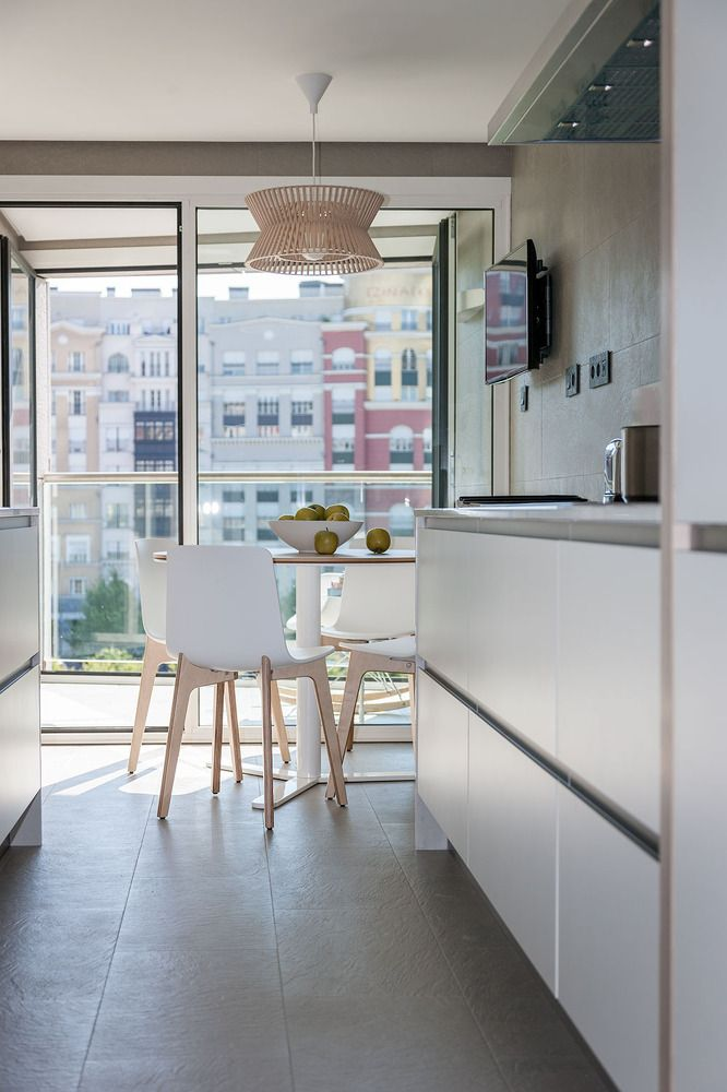 Modern Spanish Apartment Interior Design Ideas Examples. Kitchen with large wall-height window plane