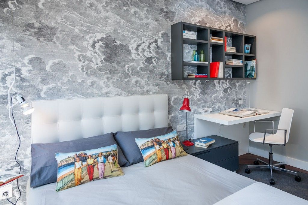 Expressive bedroom interior decorating with the wall print and soft headboard looks light