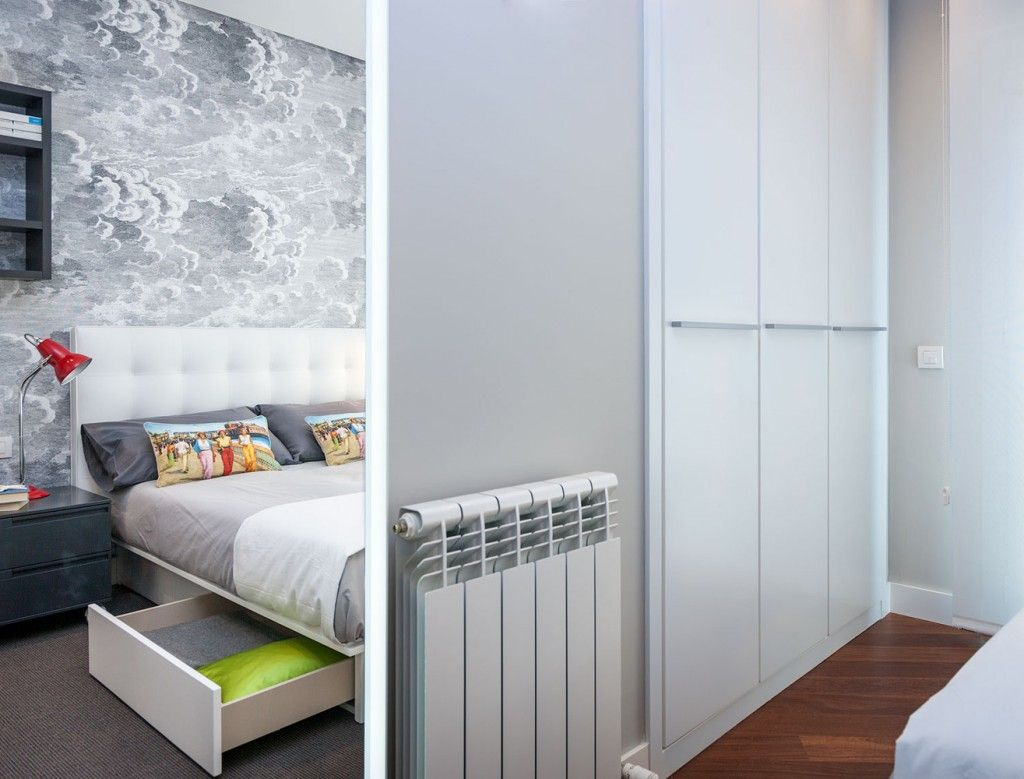 Multifunctional cabinet in the bedroom of the Spanish apartment