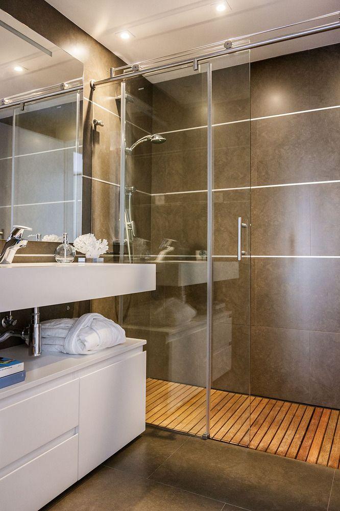 Nice minimalistic design of the gray interior of the spare bathroom