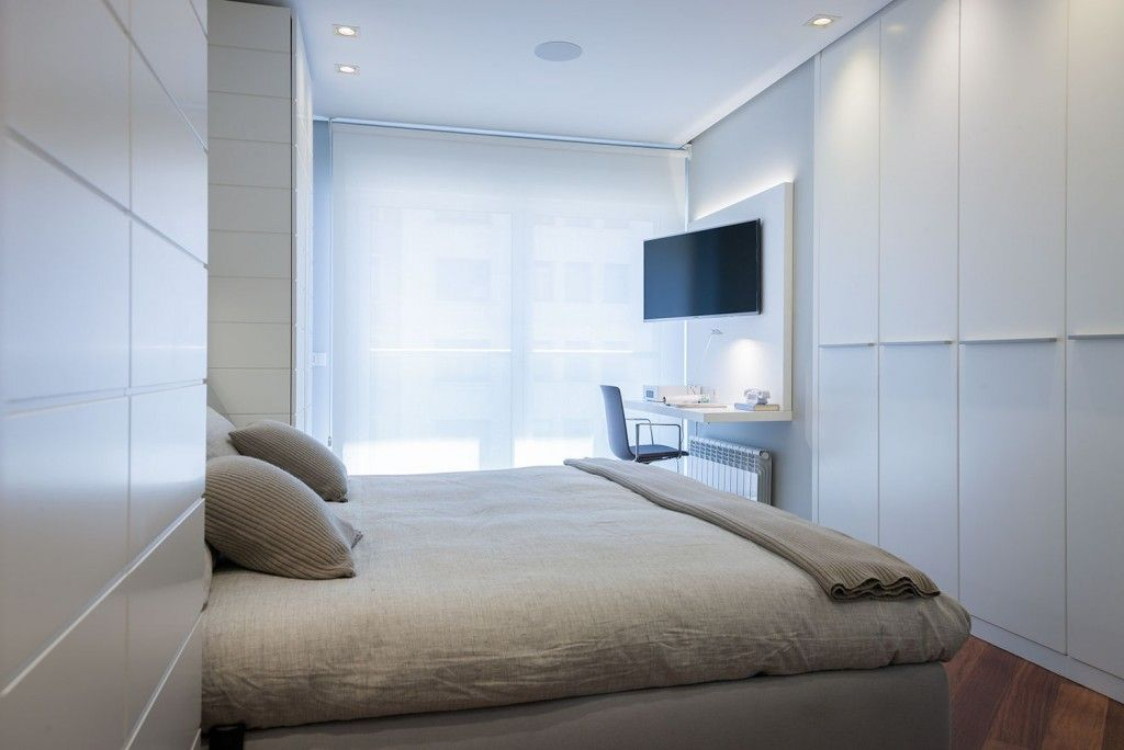 men`s minimalistic designed bedroom in gray tones