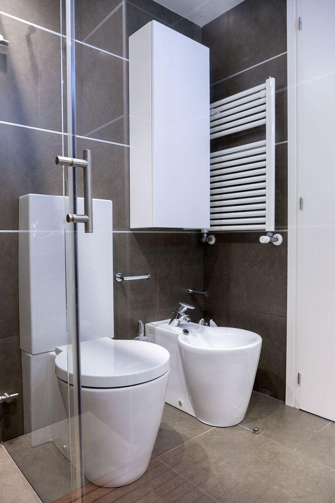 Toilet in modern gray palette bathroom